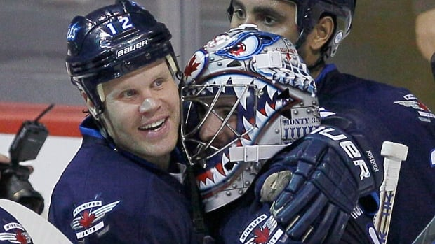 Winnipeg Jets' Olli Jokinen, seen hugging goalie Al Montoya after a win against the Detroit Red Wings earlier this month, will face his former team, the Calgary Flames, tonight at MTS Centre.