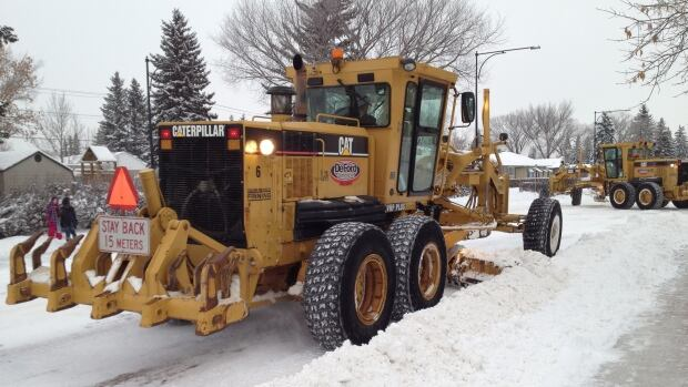 City plows hit Edmonton streets Monday morning. The city is ticketing vehicles left on snow routes.