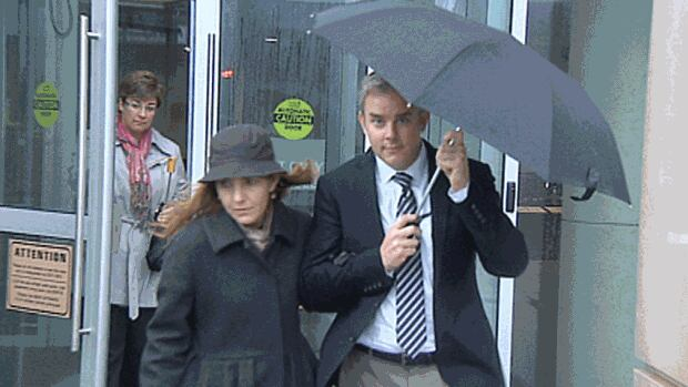 Dennis Oland leaves the Saint John Law Courts building with his wife Lisa on Monday afternoon, after being released on bail.