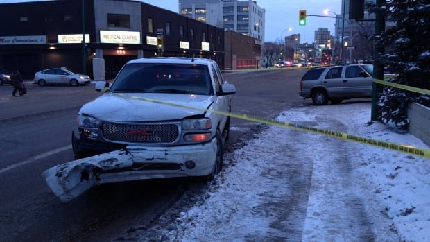 Police tape surrounds the scene of a two-vehicle crash on Ellice Avenue.
