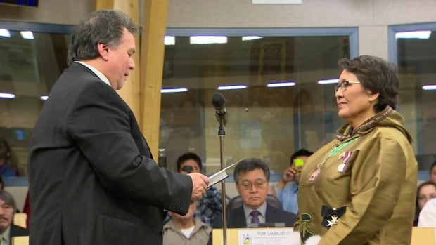 Nunavut Premier-elect Peter Taptuna is sworn in as Kugluktuk MLA by Commissioner Edna Elias Tuesday at the legislative assembly.