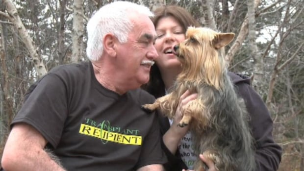 Frank Byrne, shown with his wife, Mona and family dog, says he has a new lease on life following a double lung transplant.