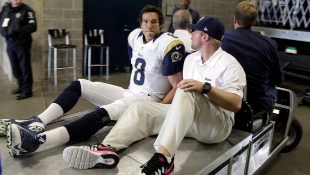 In this Oct. 20, 2013 photo, St. Louis Rams' Sam Bradford, left, is taken to the locker room after being injured during a loss to the Carolina Panthers. Bradford, who will miss the rest of the season because of a torn knee ligament, had surgery to repair the injury on Tuesday.