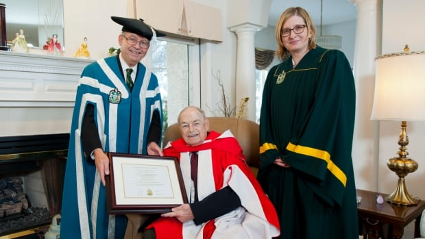 Former Premier Don Getty received an honorary Doctor of Laws from University of Alberta Chancellor Ralph Young and Registrar Lisa Collins at his home in Edmonton on Saturday.