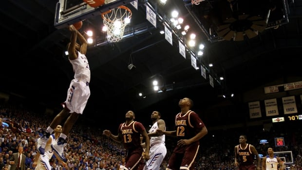 Andrew Wiggins of the Kansas Jayhawks dunks off an alley-oop against the Iona Gaels at Allen Fieldhouse on Tuesday in Lawrence, Kansas.