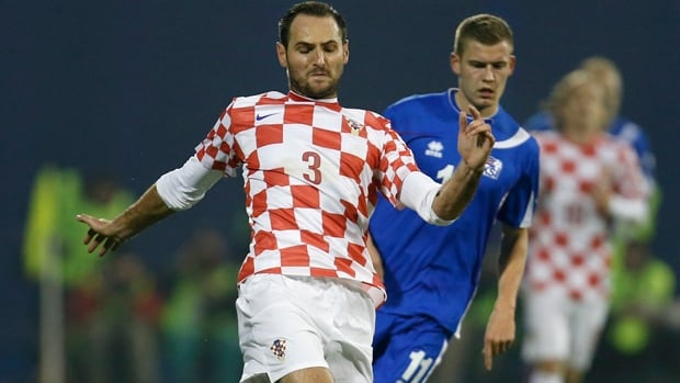 Croatia defender Josip Simunic (3) is challenged by Alfred Finnbogason in a 2-0 triumph over Iceland in Zagreb on Tuesday.
