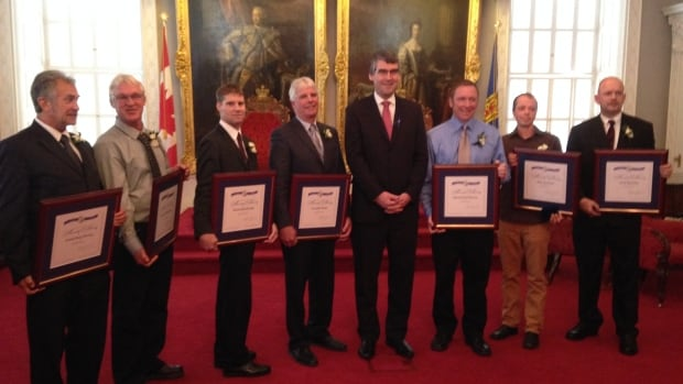 The recipients of this year's provincial medals of bravery with Premier Stephen McNeil. From left to right: Donald Mahaney, Thomas Nickerson, Thomas Hennigar, Gary Thurber, Robert Henderson, Aiden Brunn and Patrick May.