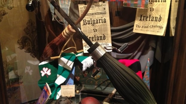 Harry and Draco's Nimbus 2000 and 2001 sit propped on a pile of Quidditch World Cup souvenirs.
