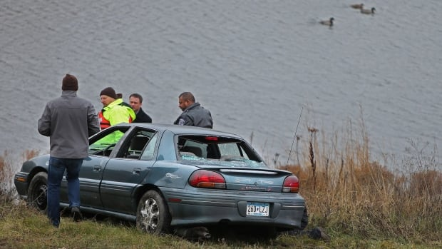 Authorities say two of five children in a car that veered off a suburban Minneapolis highway ramp and plunged into a storm water pond have died. The 23-year-old driver, who was also the mother of three of the children, escaped from the car and screamed for help, according to authorities.