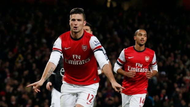 Arsenal's Olivier Giroud, left, celebrates scoring on a penalty and his second goal of the game beside Theo Walcott, right, against Southampton at the Emirates Stadium in London on Saturday.