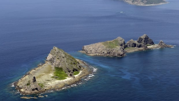 In this file photo, the tiny islands in the East China Sea, called Senkaku in Japanese and Diaoyu in Chinese are seen. The Chinese Defense Ministry has issued a map of an East China Sea Air Defense Identification Zone that includes a chain of disputed islands also claimed by Japan, triggering a protest from Tokyo.