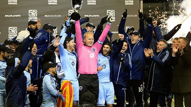 Captain Jimmy Nielsen of the Sporting KC lifts the trophy at Sporting Park on November 23, 2013 in Kansas City, Kansas.