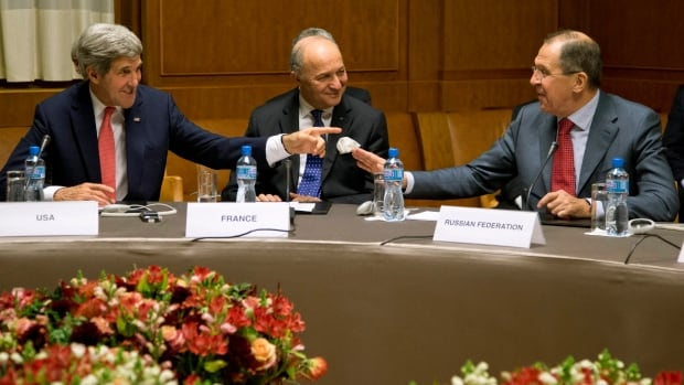 From left, U.S. Secretary of State John Kerry,  French Foreign Minister Laurent Fabius, and Russia's Foreign Minister Sergei Lavrov gather in Geneva during the Iran nuclear talks.
