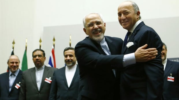 Iranian Foreign Minister Mohammad Javad Zarif hugs French Foreign Minister Laurent Fabius after a ceremony at the United Nations in Geneva on Nov. 24, 2013. Iran and six world powers reached a breakthrough agreement early on Sunday to curb Tehran's nuclear programme in exchange for limited sanctions relief.