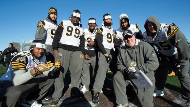 The Hamilton Tiger-Cats defensive line pose for a photo during team practice in Regina, Sask. on Saturday November23, 2013.