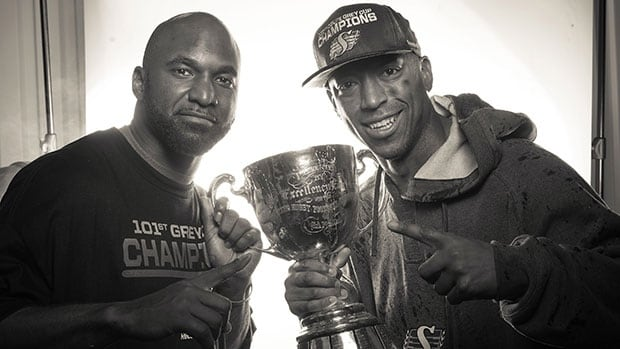 Saskatchewan quarterback Darian Durant, left, and slotback Geroy Simon pose with the Grey Cup after Sunday's win in Regina.