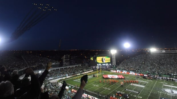The Snowbirds fly over Mosaic stadium during opening ceremonies at the Grey Cup.