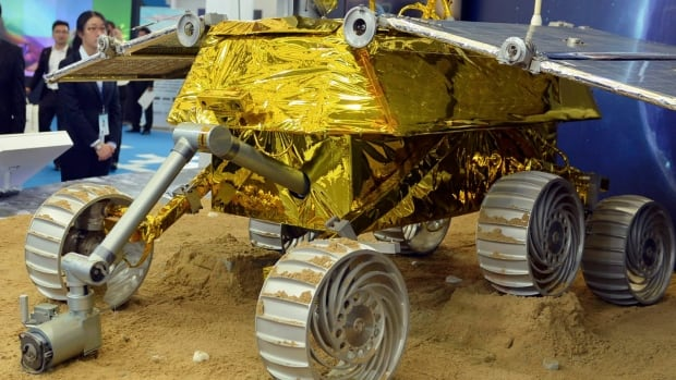 China will land its first probe on the moon in early December which will deploy a buggy, like this prototype model displayed on Nov. 5 at the 15th China International Industry Fair in Shanghai, to explore its surface.
