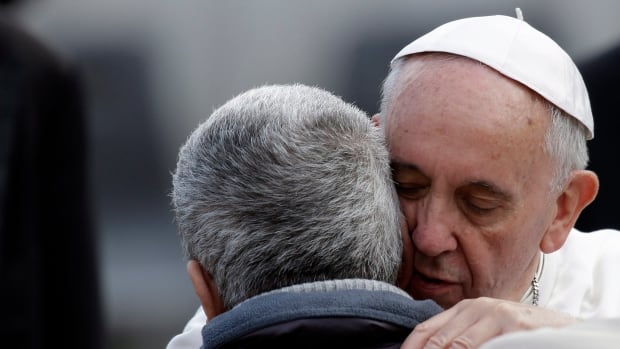 Pope Francis hugs a man at the end of his general audience in St. Peter's Square at the Vatican last week. On Tuesday, the Pope released a mission statement for his papacy in which he called for a more merciful, involved Catholic Church that is less focused on procedures and moral judgments.