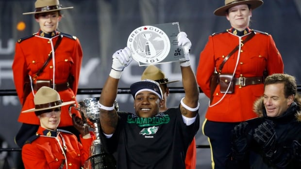 The Saskatchewan Roughriders Kory Sheets, centre, holds up the MVP trophy after receiving it from CFL Comissioner Mark Cohon, right, after the Roughriders defeated the Hamilton Tiger-Cats in the CFL's 101st Grey Cup championship football game on Sunday. Sheets is one of several Riders that become free agents this off-season.