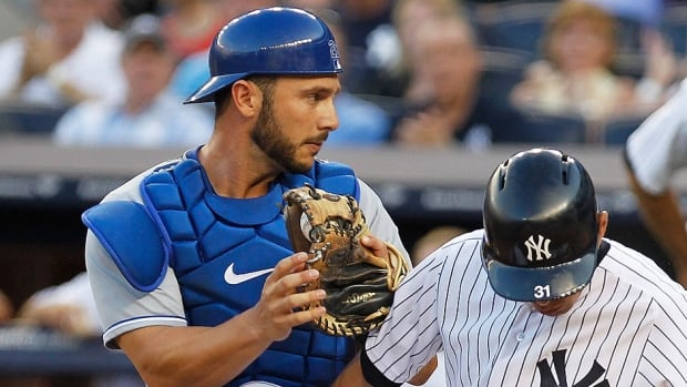 Catcher George Kottaras, left, is expected to serve as Wellington Castillo's backup with the Cubs after the team acquired him for cash from Kansas City on Tuesday. He posted a .349 on-base percentage in 126 plate appearances in 2013.