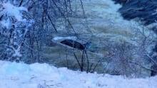 Car slides into Gatineau River