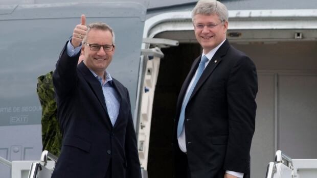 Prime Minister Stephen Harper, right, and International Trade Minister Ed Fast leave Ottawa for Europe Oct. 17, 2013.  Eight months later, there are still roadblocks to the Canada-EU trade deal they signed.