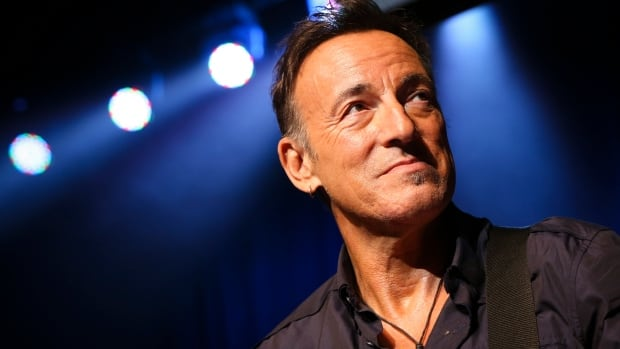 Bruce Springsteen stands on stage at the Stand Up for Heroes event at Madison Square Garden in New York on Nov. 7.