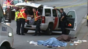 Bodies under tarps