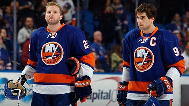 New York's Thomas Vanek, left, and John Tavares stand for a pre-game anthem on Oct. 29.