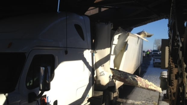 This semi-truck was wedged under the Kemnay Bridge near Brandon after the driver apparently misjudged the height of his vehicle on Thursday.