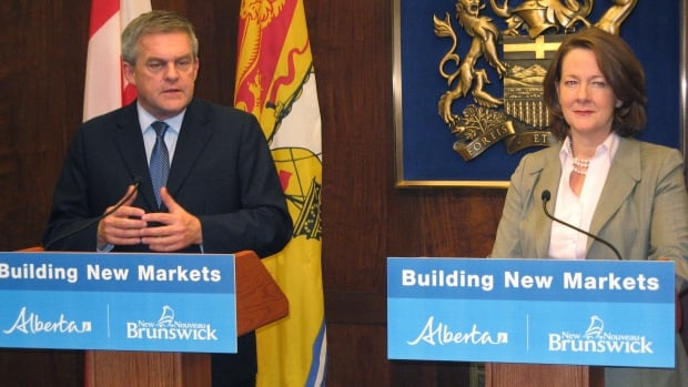 New Brunswick Premier David Alward and Alberta Premier Alison Redford speak to reporters at the Alberta legislature. Alward addressed the legislature on Thursday about the proposed Energy East pipeline.