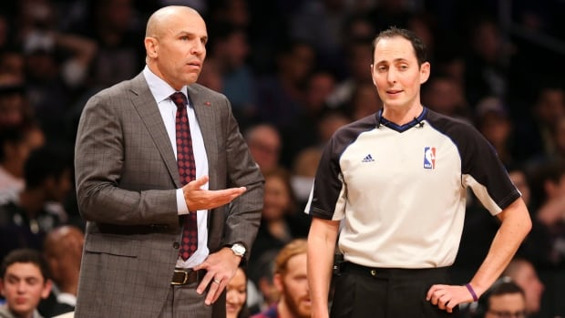 Brooklyn Nets head coach Jason Kidd, left, argues with referee Marat Kogut in the second half against the Los Angeles Lakers on Wednesday.