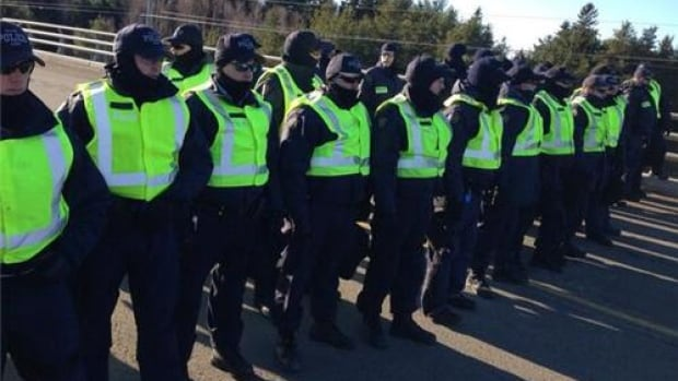 Anti-shale gas protests closed Highway 11 last year.  Here, RCMP officers gather on a highway overpass.