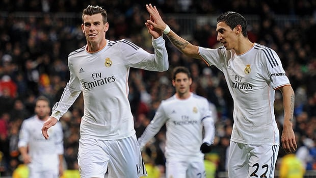 Gareth Bale of Real Madrid celebrates after scoring Real's 3rd goal against Valladolid at Santiago Bernabeu stadium on November 30, 2013 in Madrid, Spain.