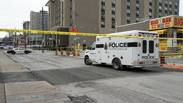 Police hold the scene of a fatal shooting in downtown Hamilton on the morning of Nov. 30, 2013.
