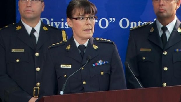 "RCMP Chief Supt. Jennifer Strachan speaks at a news conference in Toronto on Sunday. The RCMP arrested a 53-year-old man on charges of trying to sell classified information in what they call a ""threat to Canada."""