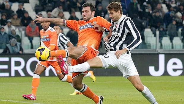 Juventus' Fernando Llorente, right, fights for the ball with Udinese's Maurizio Domizzi on December 1, 2013 at Juventus Stadium in Turin.
