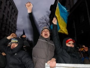 Protesters react during a rally held by supporters of EU integration in Kyiv on Dec. 1, 2013. Hundreds of thousands of Ukrainians shouting