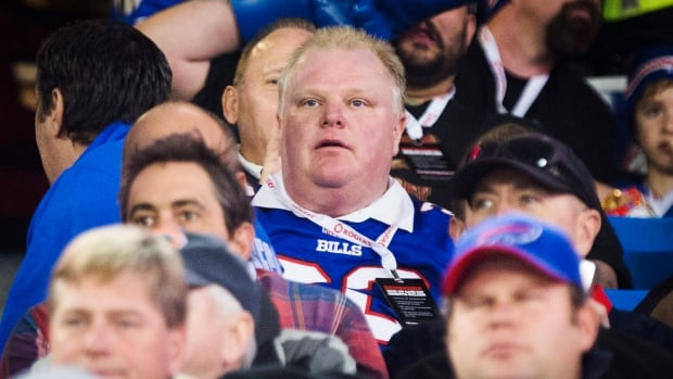Toronto Mayor Rob Ford watches the Buffalo Bills play the Atlanta Falcons during the first half of NFL action in Toronto, Sunday December 1, 2013.