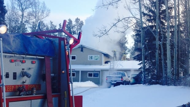 Whitehorse firefighters at the scene of a house fire in Riverdale.