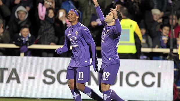 Giuseppe Rossi of ACF Fiorentina, right, celebrates after scoring a goal against Hellas Verona FC at Stadio Artemio Franchi on December 2, 2013 in Florence, Italy.