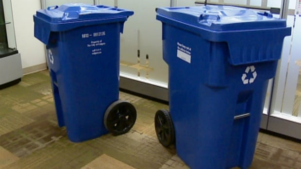 The blue recycling bin on the right has 50 per cent more capacity than the standard 240-litre cart.