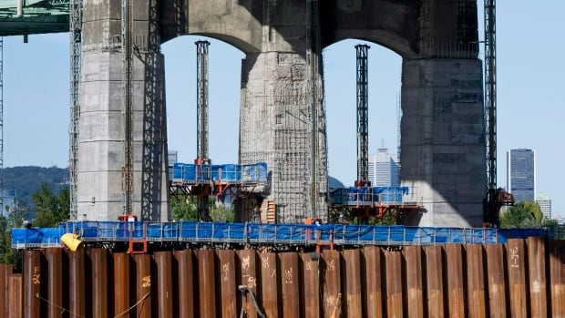Repair work proceeds on pillars of the Champlain Bridge linking Montreal in an October 5, 2011 photo from in Brossard, Que. The continuing deterioration of a supporting beam in one of Canada's busiest bridges has prompted more emergency repairs.
