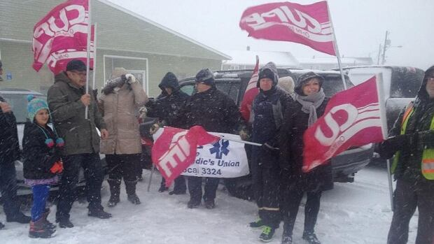 Kensington town workers were out picketing in a storm Wednesday morning after being locked out late Tuesday afternoon.