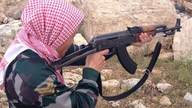 A 21-year-old from Denmark poses for a photo as if he was shooting with an AK47 rifle at a training camp inside Syria near Idlib in May 2013. The number of foreign fighters in Syria is increasing, according to a note for a meeting by the services of EU Counter-Terrorism Co-ordinator Gilles de Kerchove.