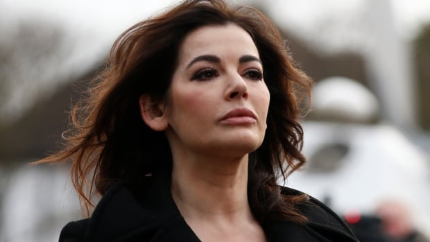 Celebrity chef Nigella Lawson arrives at Isleworth Crown Court in London on  Thursday for a second day of testimony as a prosecution witness in the fraud trial of her former employees Elisabetta and Francesca Grillo.