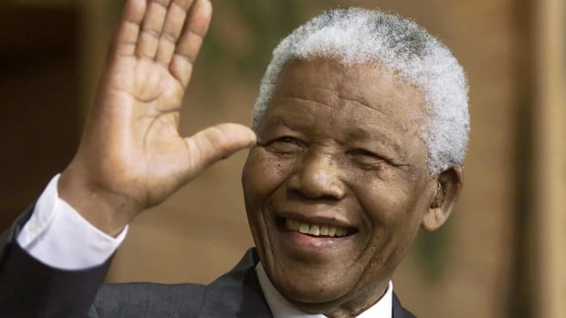 Former South African president Nelson Mandela waves to the crowd during a ceremony in Quebec, - nelson-mandela-20131205