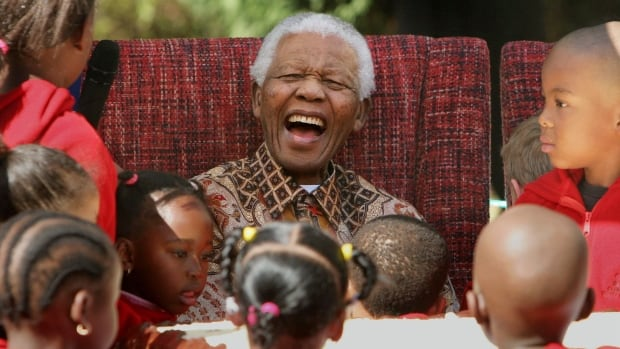 Nelson Mandela celebrates his birthday with children at the Nelson Mandela Children's Fund in Johannesburg, in July 2007. The anti-apartheid leader died Thursday.