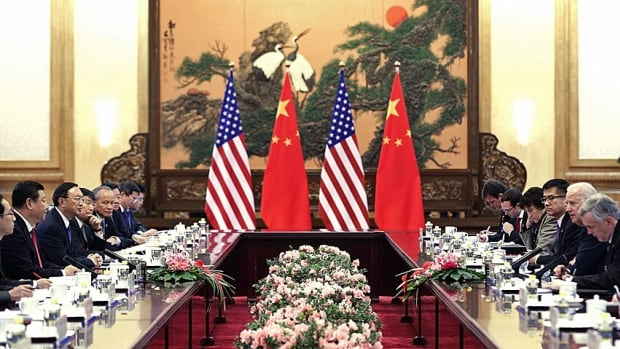 China's President Ji Xinping faces off across a crowded room with a visiting U.S. Vice-President Joe Biden earlier this week. Beijing stressed it has no intention of backing away from its new air defence zone.